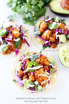 Roasted Cauliflower and Chickpea Tacos - top warm corn tortillas with roasted chickpeas and cauliflower, chopped red cabbage, jalapeño slices, avocado, cilantro, and lime crema. .