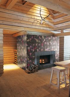 Hand-made Ceramic wall tiles TULI POP 2 by CERAMICA BARDELLI | #Design Ronald Van Der Hilst #flower #tulip #fireplace #wood