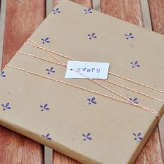 Simple wrapping gift idea. (stamps, brown paper bags, and twine)