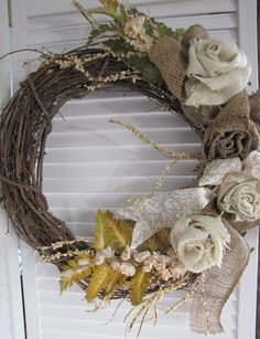 #Burlap #wreaths, burlap roses! burlap! burlap! All on the #grapevine wreath  www.facebook.com/wreathswithareason