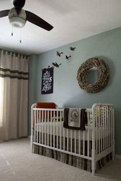 This #nursery is all-boy. Hunting, travel and animal inspired room