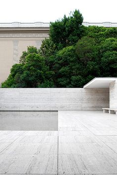 Beautiful sober view of the back wall of the Barcelona Pavilion by Mies van der Rohe. Photo by 010lab.