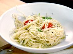 Capellini with Tomatoes and Basil: olive oil, garlic, cherry tomatoes, basil, parsley, fresh thyme, salt, pepper, red pepper flakes, capellini or angel hair pasta, Parmesan.