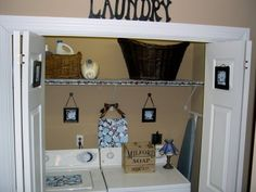 maybe if I paint the inside of the laundry closet it will make laundry more fun ;)  Love the laundry letters too.