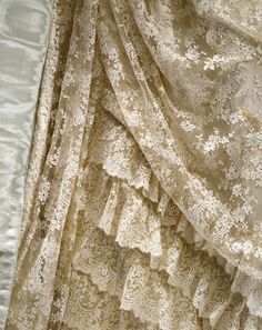 Detail of a moiré silk-overlayaid and machine lace-trimmed skirt, lined with satin. Designer unknown, c. 1885. ^