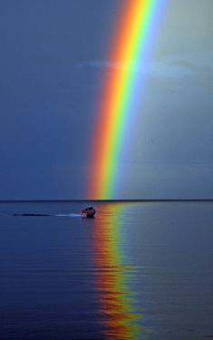 """Rainbow over Lake Ontario"" ~ ""A beautiful rainbow came out over the lake and a rescue boat passed in front""  • photo: Melagoo"