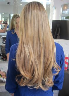 Long and honey blonde highlights. Color by Lauren Ashley.