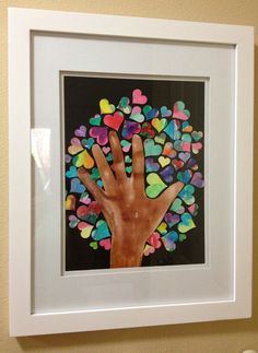Class Art piece for school auction. Would also be good as a end of the year teacher gift. Kids water colored small piece of drawing paper and then used di cut to cut hearts out. Teachers hand was used as the trunk.