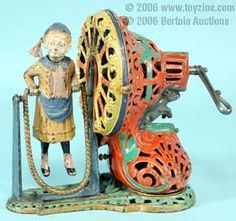 cast iron cars and tin toys