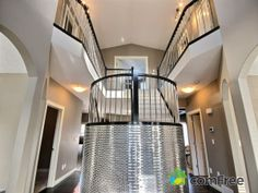 Shiny staircase in Airdrie, AB. What do you think? #ComFree #InteriorDesign