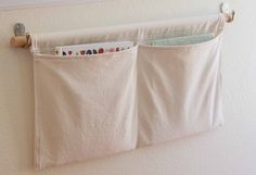 DIY: wall pockets.  Good idea for magazines in small bathroom, or near kids' beds for bedtime stories.