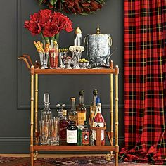 Festive Bar Cart Welcome | This brass bar cart by Arkansas native Bronson van Wyck features Southern-made essentials | SouthernLiving.com
