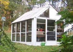 greenhouse made with old storm doors. we have about eight sliding glass doors we want to fashion this way. we plan to use it for seed starting in the winter and spring.