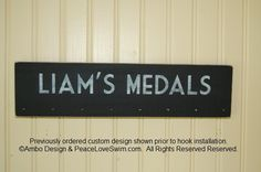 Boy's Personalized Swimming Ribbon and Medal Display Hanger.  Only available at www.PeaceLoveSwim.com