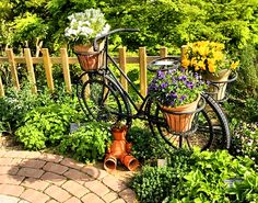 Wallcoo.net adds visual interest to this garden path with this planter bike.