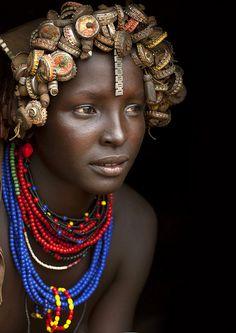Dassanech girl with bottlecap headpiece - Omorate, Ethiopia