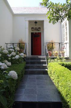 red door + landscaped entranceway