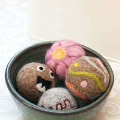 Felted Dryer Balls ... Anything that saves money and eliminates some of the chemicals we use in our day to day life is good in my book. Plus, I have to admit I love the fun factor of being able to dress up these cute felted wool dryer balls! Free tutorial for you to make your own ... #ecofriendly #greenliving #natural #felted #dryerballs #laundry