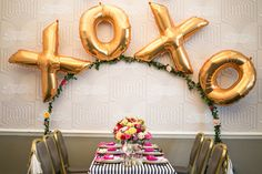 XOXO table backdrop // photo by Anneli Marinovich Photography // View more: http://ruffledblog.com/kate-spade-inspired-wedding-event/