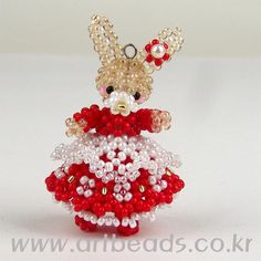 Beaded Bunny in red dress with pattern
