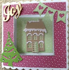 Centre of card cut out with Sizzix squares. Tree and house both marianne designs