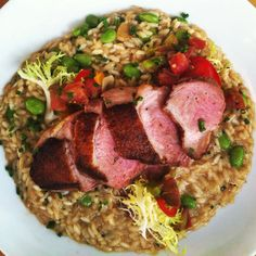Seared duck breast with marinated heirloom tomatoes and edamame risotto