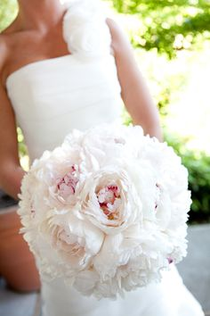 White peonies with pink centers