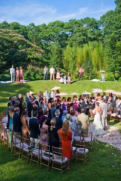 ...semi-circular seating with bride entering toward guests, so that they're not looking at the couples' backs...