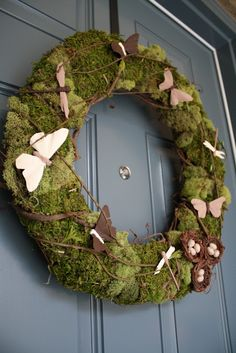 Moss wreath with butterflies and nests