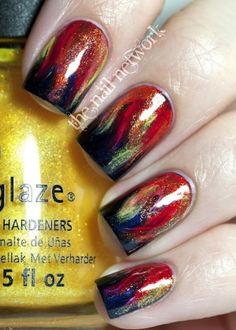 girl on fire hunger games nails by thebigbiglemon