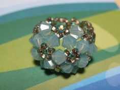 How to make a Double-Flower Ring daili bead, bead ring, diy tutorial, beaded rings, swarovski crystals, seed beads, jewelry making tutorials, diy rings, flower