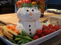 Snowman cheese ball appetizer with veggies and crackers