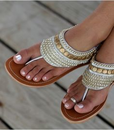 Bright beading coupled with gold studding and crystal beads make this ankle strap sandal a real head turner.    Hand made in India    Genuine Leather Upper, with contrast white stitching    Flat Leather Sole, with very small non slip heel