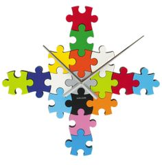 Karlsson's Wall Clock features 17 jigsaw puzzle pieces so that you can create your own clock and the Amazon customer reviews make it sound like fun. #clocks #jigsawpuzzles