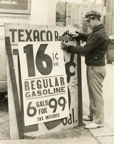 6 gallons for a buck. Gas station prices at Roosevelt and Wabash, c.1939, Chicago.