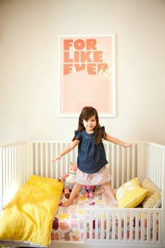 little girl's room, For Like Ever poster, bla bla dolls, DwellStudio bedding, pink, yellow (Style at Home: Erika of Small Shop Studio. Photographed by Jennifer Daigle)