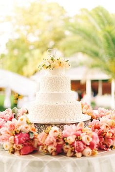 Floral covered wedding cake display: http://www.stylemepretty.com/louisiana-weddings/2014/10/20/fun-and-colorful-louisiana-outdoor-wedding/ | Photography: Arte de Vie - http://artedevie.com/