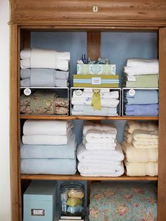 Stacking towels and linens on dish risers may fix the Dreaded Tower of Towels in my linen closet.