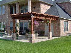 Pergola with brick base columns in Katy Grand Lakes by Texas Custom Patios