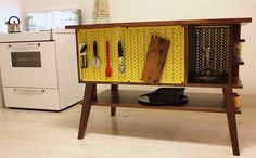 A very cool and creative custom use for Wall Control metal pegboard. Wall Control's yellow metal pegboard is being integrated into a custom Walnut Kitchen Island Work Station for added storage space to maximize versatility!