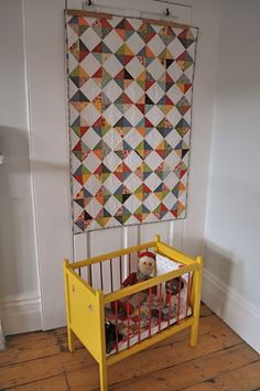 Hourglass quilt made with Sandy Klop/American Jane fabric and vintage crib/teddies