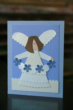 handmade paper pieced cards ... Christmas angle in white and blue ... punch art ... like the rustic look of the angel ... clean lines ... lovely card!