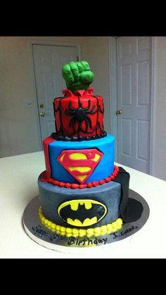 Superhero cake for Boys 5th Birthday! Take out Super Man and add in Iron Man & Thor! Perfect cake for my boys upcoming birthday! *(I know it mixes DC Comics & Marvel, but those are their Favorite Superheroes!!) birthday parties, 5th birthday, boy cakes, super hero cakes, super hero birthday, groom cake, little boy birthday, superhero cake, birthday cakes