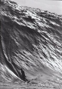 Surfing b/w This is some extreme surfing. That is 1 giant wave