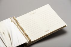 Inside, crystals and pearls line the inner side of the cover, as soft mulberry paper and gold lines provide the perfect pages for guests to write their best wishes to the bride and groom.