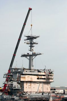 The final section of USS Theodore Roosevelt's main mast put in place--a major milestone for Newport News shipbuilders
