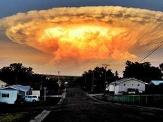 A cloud that looks like a mushroom cloud but is actually a cumulonimbus cloud with the perfect ray of afternoon sun light