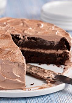 Chocolate-Zucchini Cake -- You'd never guess there's a bumper crop of shredded zucchini in this super-moist double-chocolate dessert recipe made with cake mix and chocolate pudding.