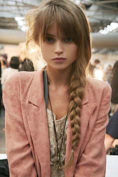 long braid and bangs.
