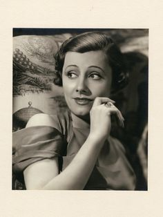 Trio of oversize exhibition portraits of Irene Dunne by Ernest A. Bachrach. Silver bromide matte borderless 8 1/2 x 11 in. double-weight prints (3) of Irene Dunne by Ernest A. Bachrach, custom-mounted to approx. 15 x 20 in. presentation mats, and from his private collection. One is signed on mat by Bachrach, and dated 1933.